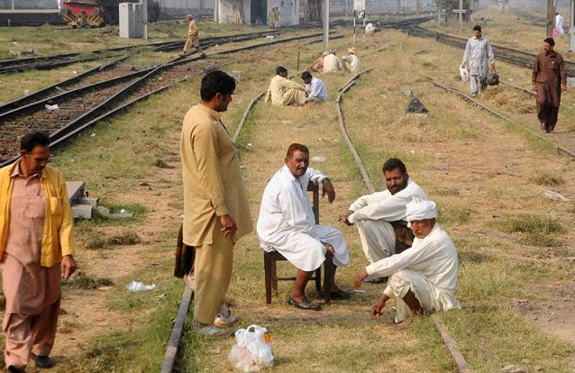 Railways employees sitin on the railways lines