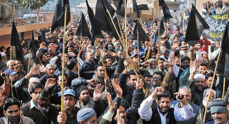 Employees of Postal Department carrying Black Flags in rally against privatization at GPO Lahore