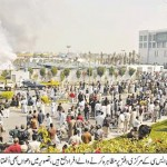 KESC Central office protest view of workers also rising smoke in visible - Daily Jang Karachi Pic 21-1-2011