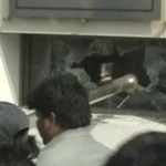Screenshot taken by Samaa tv of the the workers attacking the KESC office in Karachi on January 20 2011