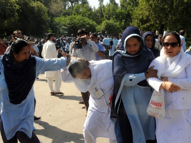 Policewomen man handle paramedical staff as they protest in Islamabad